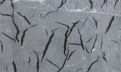 Proven solution of resin filtration control and mesh adhesion in marble and granite slabs